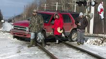 Protesters block the Canadian National rail line between Halifax and Truro, N.S., as part of the Idle No More protests on Millbrook First Nation on Friday, Jan.11, 2013. (Andrew Vaughan/The Canadian Press)