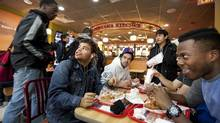 Students from Toronto's Central Technical School enjoy lunch at Popeyes Louisiana Kitchen. School bans on junk food have driven students to fast food restaurants at lunchtime. (Deborah Baic/The Globe and Mail)