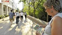Mature student Patricia VanOostveen falls back from her tour group to get her bearings on a campus map at York University September 2, 2010. (J.P. Moczulski/The Globe and Mail)/J.P. Moczulski/The Globe and Mail))