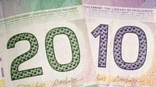 Canadian currency (Adam Korzekwa adam@korzekwa./iStockphoto)