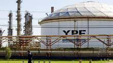 Spanish oil company Repsol has filed a U.S. lawsuit to block Chevron's partnership with YPF. (Natacha Pisarenko/AP)