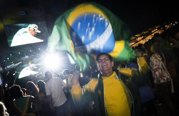 People dance to music on Olympic Boulevard in Rio's old port district during the night of the Olympic opening ceremony on Friday, August 5, 2016.