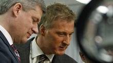 Prime Minister Stephen Harperand Conservative MP Maxime Bernier tour a college science lab in St-Georges de Beauce, Que., on October 23, 2009. (MATHIEU BELANGER/REUTERS)