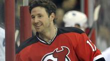 New Jersey Devils left wing Ilya Kovalchuk grins as he comes to the bench after the Devils scored against the Toronto Maple Leafs in the first period of their NHL hockey game in Newark, New Jersey, February 5, 2010. REUTERS/Ray Stubblebine (RAY STUBBLEBINE)