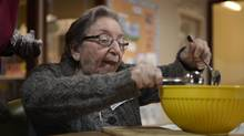 Therese Holtzman making cookies at the Dementia Support Dov & Zipora Burstein Senior Centre. (Fred Lum/The Globe and Mail)