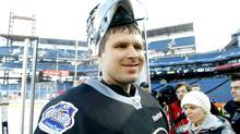 Philadelphia Flyers' goalie Ilya Bryzgalov leaves the ice following practice for the Winter Classic hockey game, Sunday, Jan. 1, 2012, in Philadelphia. The Flyers are slated host the New York Rangers outdoors on Monday. (AP Photo/Tom Mihalek) (Tom Mihalek/AP)