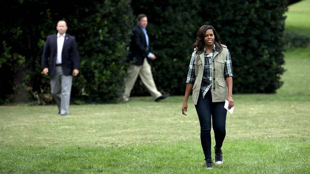 First lady Michelle Obama arrives for a harvesting event at White House Kitchen Garden on the South Lawn of the White House October 6, 2016 in Washington, DC.