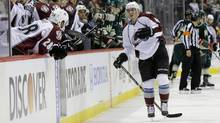 Colorado Avalanche defenseman Tyson Barrie, right, leaves the ice after getting injured on a hit by Minnesota Wild left wing Matt Cooke during the second period of Game 3 of an NHL hockey first-round playoff series in St. Paul, Minn., Monday, April 21, 2014. (Associated Press)