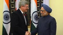 Prime Minister Stephen Harper shakes hands with India's Prime Minister Manmohan Singh following a signing ceremony in New Dehli, India on Tuesday, Nov. 6, 2012. (Sean Kilpatrick/THE CANADIAN PRESS)