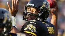 Hamilton Tiger-Cats quarterback Henry Burris throws a pass against the Montreal Alouettes in the first half of their CFL football game in Hamilton July 21, 2012. (FRED THORNHILL/REUTERS)