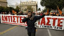 Members of Greece's public power corporation workers union (GENOP) march during a protest in Athens February 9, 2012. (YIORGOS KARAHALIS/YIORGOS KARAHALIS/REUTERS)