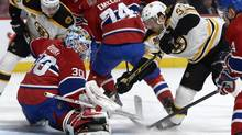 Montreal Canadiens goalie Peter Budaj makes a save on Boston Bruins forward Patrice Bergeron, right, during the first period of an NHL game at the Bell Centre in Montreal on March 12, 2014. (Eric Bolte/USA Today Sports)