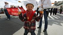 Liam Kirkness gets ready for the start of the annual Stampede parade during the 100th anniversary of the Calgary Stampede in Calgary, Alberta, July 6, 2012. REUTERS/Todd Korol (CANADA - Tags: SOCIETY SPORT) (TODD KOROL)