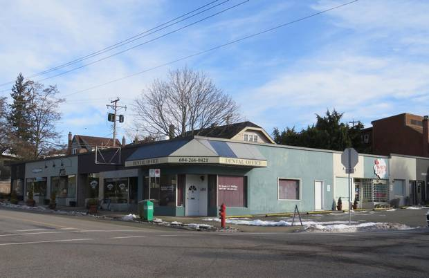 A small Kerrisdale strip mall slated for redevelopment. The proposal would reduce eight shops to three while adding condominuims.