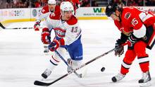 Michael Cammalleri of the Montreal Canadiens tries to chip the puck past Erik Karlsson of the Ottawa Senators in a game at Scotiabank Place on Saturday. (Phillip MacCallum/Getty Images)
