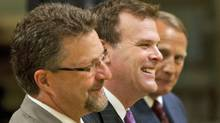 Government House Leader John Baird smiles alongside Chuck Strahl and John Duncan as they are sworn in to their new cabinet positions at Rideau Hall on Aug. 6, 2010. (Sean Kilpatrick/THE CANADIAN PRESS)
