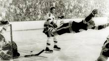 Top: Bobby Orr flies through the air with his arms outstretched after scoring the goal that clinched the 1970 Stanley Cup against the St. Louis Blues. (RAY LUSSIER/AP)