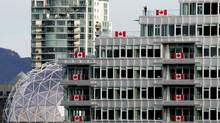 The Olympic Village lined with Canadian flags in Vancouver, B.C., on Thursday February 4, 2010. (Darryl Dyck/ The Canadian Press/Darryl Dyck/ The Canadian Press)