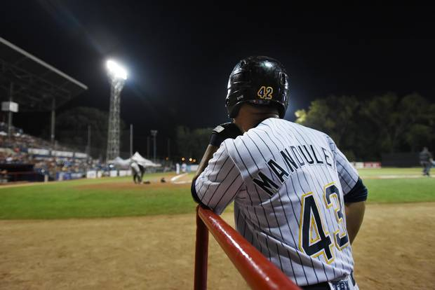 Yordan Manduley waits for his turn at the plate during game against the Garden State Grays at Stade Municipal in Quebec City. The 29-year-old hopes the Can-Am League experiment will mean to bigger and better things for his baseball future.