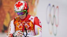 A dejected Erik Guay at the finish line after placing 10th over all in the mens Downhill at the Sochi Winter Olympics February 9, 2014. (John Lehmann/The Globe and Mail)
