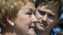 PQ leader Pauline Marois responds to a question as candidate Leo Bureau-Blouin looks on Monday, September 3, 2012 in Cap-Rouge, Que. Quebecers go to the polls Tuesday to elect a new provincial government. (Paul Chiasson/The Canadian Press)