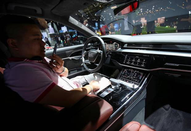 A Man Views The Interior Of New Audi A8