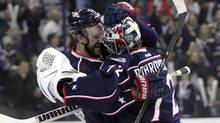 Columbus Blue Jackets' Nick Foligno, left, and Sergei Bobrovsky, of Russia, celebrate Foligno's game-winning goal against the Pittsburgh Penguins in Game 4 of a first-round NHL playoff hockey series on Wednesday, April 23, 2014, in Columbus, Ohio. (Associated Press)