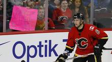 "A Calgary Flames' fan holds up a sign that reads ""a welcome back"" in front of Cory Sarich during the third period of their NHL hockey game against the San Jose Sharks in Calgary, Alberta, January 20, 2013. (Todd Korol/Reuters)"
