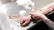 Richard Chenery injects heroin he bought on the street at the Insite supervised injection clinic in Vancouver May 11, 2011. (JOHN LEHMANN/JOHN LEHMANN/THE GLOBE AND MAIL)