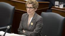 Ontario Premier Kathleen Wynne listens to comments from across the floor at Queen's Park on March 4, 2013. Ms. Wynne's government has made peace with the Elementary Teachers' Federation of Ontario, but does so at a steeper price than previously thought. (Peter Power/The Globe and Mail)