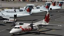 Air Canada has cited lower airfares because of growing competition as its reason for looking to cut costs. (MIKE CASSESE/REUTERS)