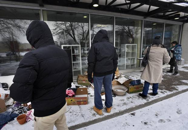 Unaware that the Goodwill store and drop off location at 60 Overlea Blvd was closed, shoppers sort through items left outside the store.