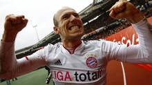 Arjen Robben, Dutch forward of Bayern Munich celebrates his winning goal after their German first division Bundesliga soccer match against FC Nuremberg in Nuremberg, March 31, 2012. Bayern won the match 1-0. REUTERS/Kai Pfaffenbach (Kai Pfaffenbach/Reuters)