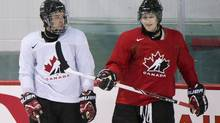 Team Canada hockey junior prospects Connor McDavid, left, and Nathan MacKinnon chat during Canada's National Junior Team training camp in Brossard, Que., Sunday, August 4, 2013. (GRAHAM HUGHES/THE CANADIAN PRESS)