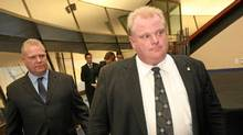 Councillor-elect Doug Ford, left, follows Toronto mayor-elect Rob Ford to a media conference at City Hall on Nov. 29, 2010. (Tim Fraser For The Globe and Mail)