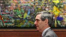 Liberal Leader Michael Ignatieff walks past a painting as he arrives for a news conference in Vancouver on Sept. 4, 2009. (DARRYL DYCK)