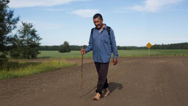 Like many members of his community, Gabriel Aginus, 63, makes the journey to Lac Ste. Anne from Alexis Nakota Sioux Nation, Alberta as a sacrifice for the sick and people who've passed on Wednesday, July 22, 2015.