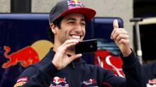 Toro Rosso driver Daniel Ricciardo of Australia gestures to the crowd as he takes a photo during Open House Day ahead of the Canadian F1 Grand Prix at the Circuit Gilles Villeneuve in Montreal, in this June 6, 2013 file photo. Australian Ricciardo will replace compatriot Mark Webber at Formula One world champions Red Bull next year, the team announced on September 3, 2013. (CHRISTINNE MUSCHI/REUTERS)