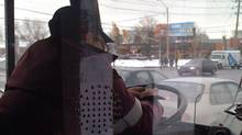TTC passenger Alexia Schell took this photograph of a driver using a mobile phone behind the wheel of a bus on January 25, 2010.