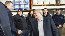Conservative Leader Stephen Harper greets supporters at a rally in Yellowknife on April 18, 2011. (Frank Gunn/The Canadian Press/Frank Gunn/The Canadian Press)