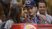 Actors Mila Kunis, left, and Ashton Kutcher watch the Los Angeles Clippers play the Detroit Pistons during the second half of an NBA basketball game, Saturday, March 22, 2014, in Los Angeles. (Mark J. Terrill/AP)