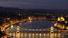 The Chain Bridge connects Buda with Pest across the Danube. (BERNADETT SZABO/REUTERS)