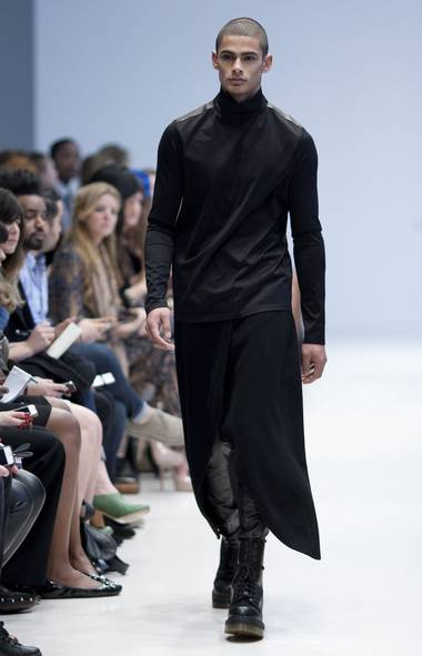 Shrouded in a mostly black palette, Toronto's Sid Neigum focused predomintely on men's wear this season. Hard-edged leather, a Neigum favourite, stood against draped tops, skirts and dresses over slim trousers for a decidedly unisexy feel. (Chris Young/CP)