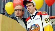 Erie Otters general manager Sherwood Bassin, left, introduces Connor McDavid as the No. 1 pick in the OHL Priority Selection during an OHL hockey draft party in Erie, Pa., Friday, April 6, 2012. (AP Photo/Erie Times-News, Janet B. Kummerer) (Janet B. Kummerer/AP)
