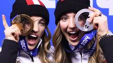 Canadian sisters Justine Dufour-Lapointe, left, and Chloe Dufour-Lapointe, right, show off their gold and silver medals from women's freestyle moguls after the medal ceremony at the 2014 Sochi Winter Olympics in Sochi, Russia on Sunday, February 9, 2014. (Nathan Denette/THE CANADIAN PRESS)