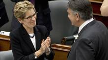 Ontario Finance Minister Charles Sousa is congratulated by Premier Kathleen Wynne after tabling the provincial budget on May 2, 2013. (MOE DOIRON/THE GLOBE AND MAIL)