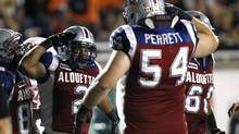 Montreal Alouettes' Brandon Whitaker (2) celebrates his touchdown with Jeff Perrett (54)during their CFL game in Montreal, August 31, 2012. (OLIVIER JEAN/REUTERS)
