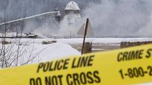 Smoke rises as police tape surrounds the Babine Forest Products mill in Burns Lake, B.C. Saturday, Jan. 21, 2012. Family members reacted with dismay Monday to an announcement last week that Crown counsel would not proceed with charges after what it described as a flawed investigation by WorkSafeBC into the sawmill explosion two years ago. (JONATHAN HAYWARD/THE CANADIAN PRESS)