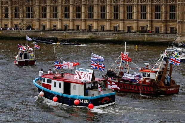 Fishermen and campaigners for the Leave campaign demonstrate in boats outside the Houses of Parliament in London on June 15, 2016.