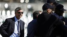 Detroit Tigers general manager Dave Dombrowski, left, watches batting practice during a workout at Comerica Park in Detroit, Monday, Oct. 22, 2012. When Dombrowski first took over as president of the Detroit Tigers, they lost 225 games his first two seasons. But in 2004, Detroit drafted Justin Verlander, the first step toward building one of baseball's glamour teams in the heart of the Motor City. (Paul Sancya/AP)